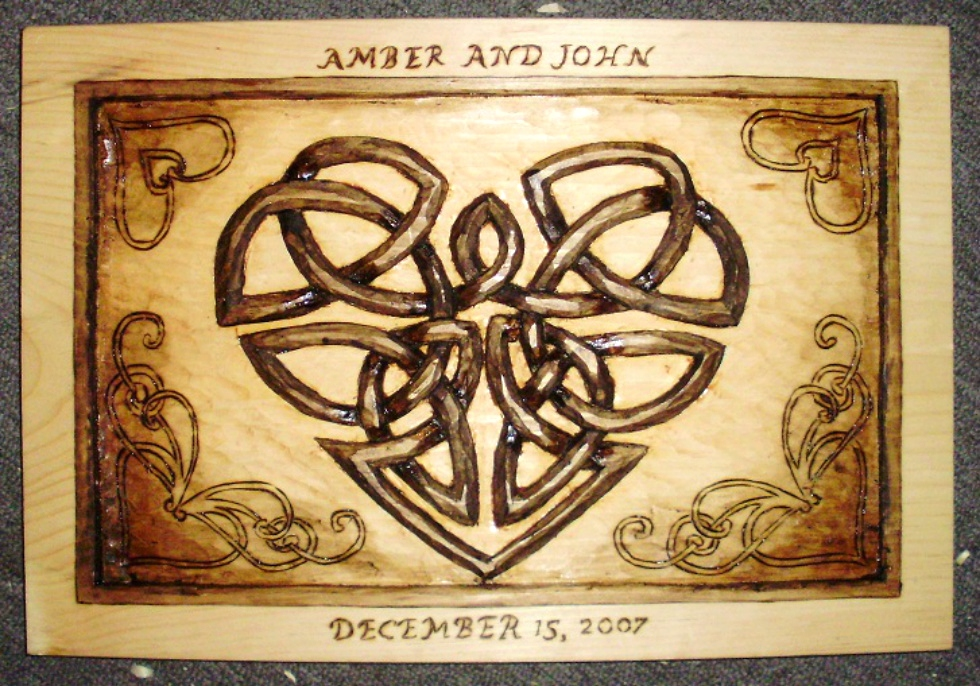Hand Carved Celtic heart Wood Carvings